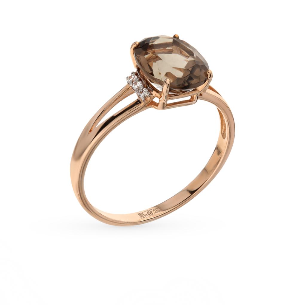 Фото «золотое кольцо с фианитами и раухтопазами (кварцами дымчатый)»